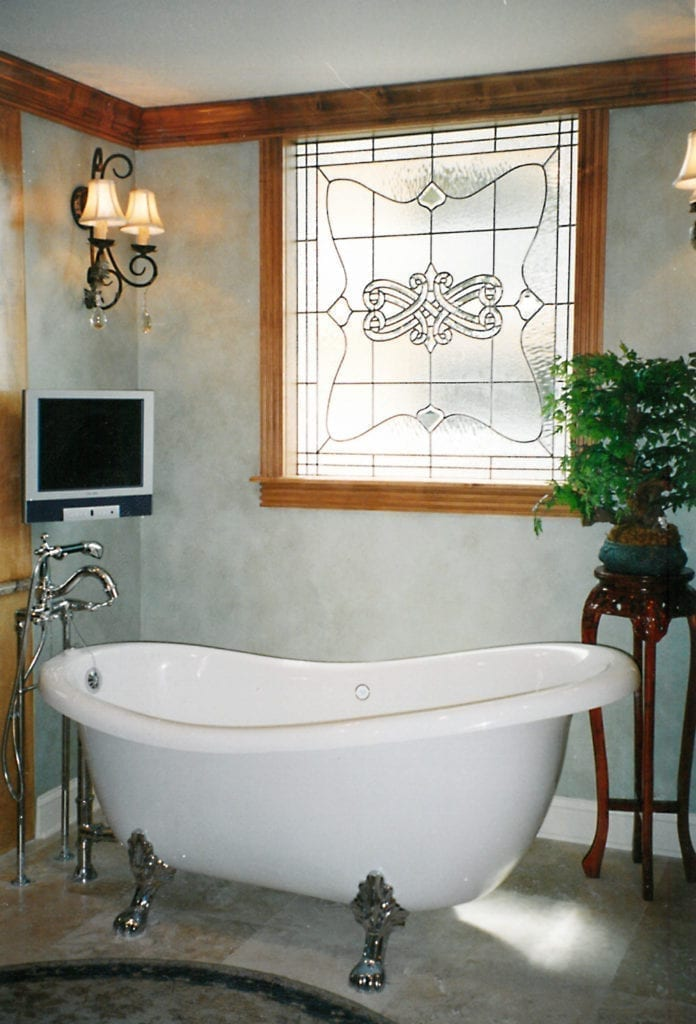 A stained glass bathroom window