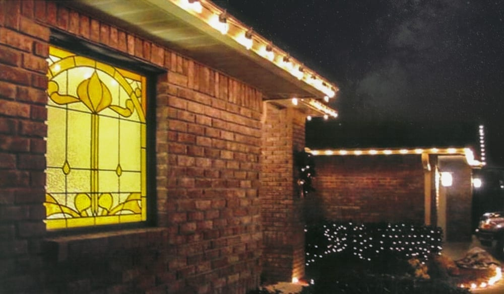 Stained glass window design from the outside of a house