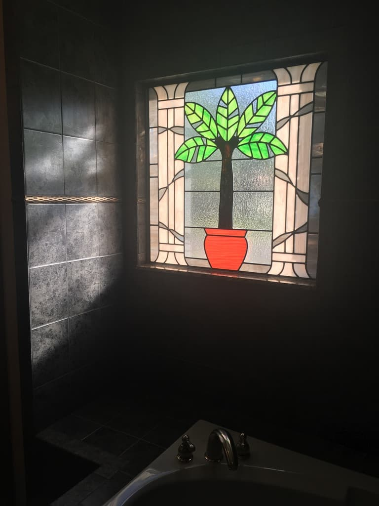Stained glass bathroom window design from the interior of a home