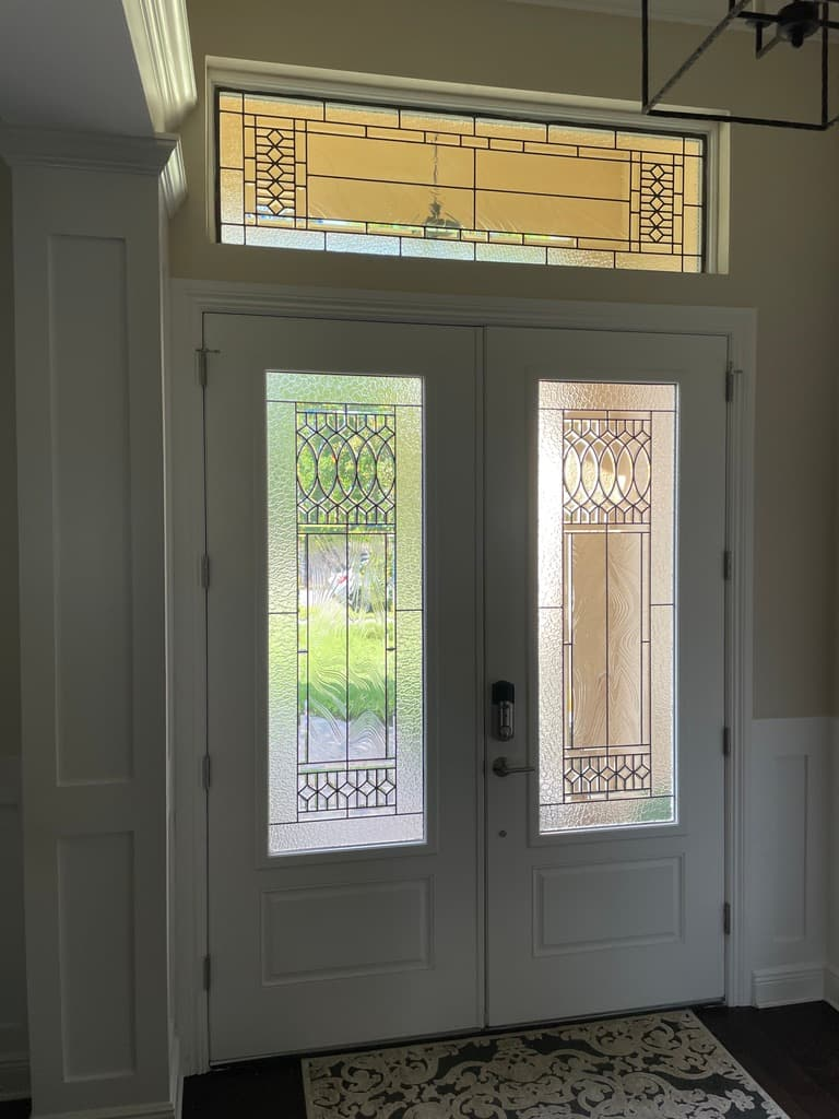 Stained glass door design viewed from the interior of a home