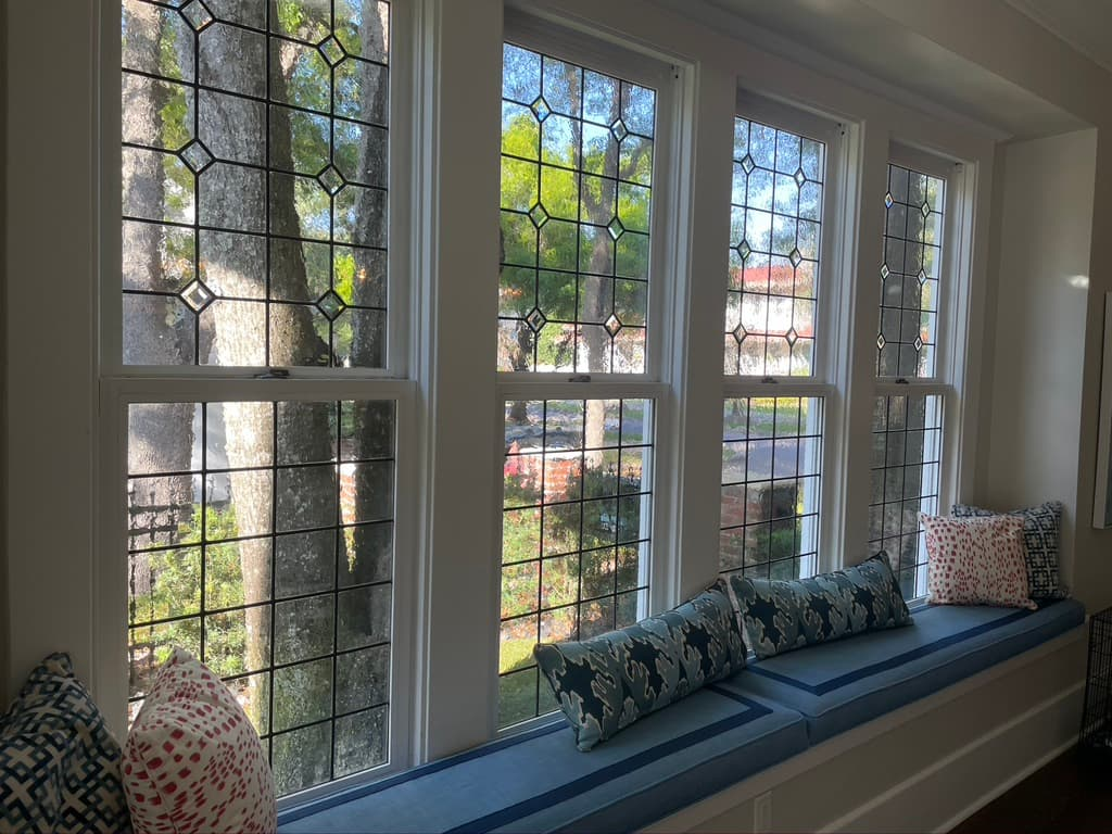 Stained glass living room window design viewed from the interior of a home