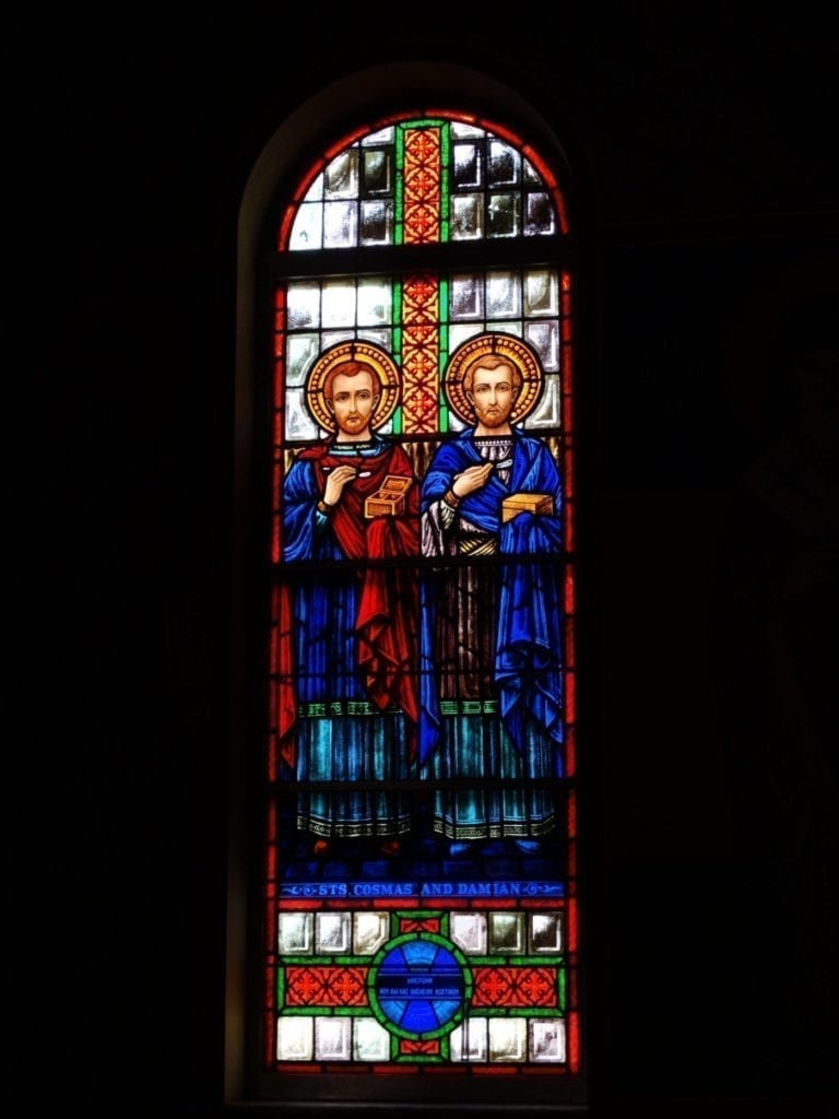 Stained glass church window design viewed from the interior of a church