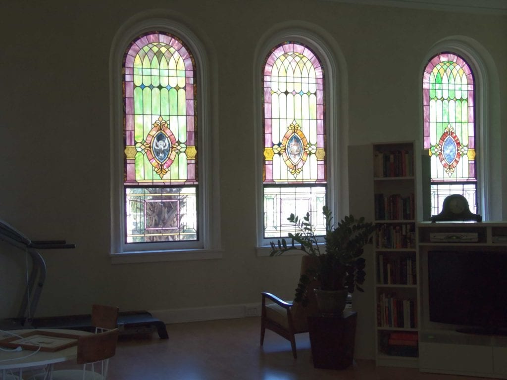 Stained glass viewed from the interior of a church
